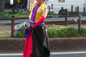 The costumes are colorful and flowing, often based around traditional clothing