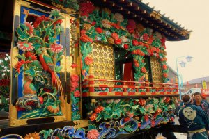 While most floats are detailed carvings, this float stands proud in a rainbow of painted colors