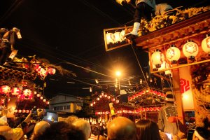 Several floats gather for a taiko drum battle