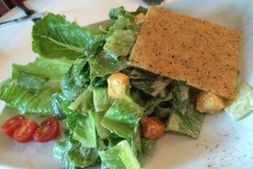 <p>The Caesar Salad doesn&#39;t look all that glamorous, but it was definitely tasty being&nbsp;topped off with a thin block of parmesan cheese</p>