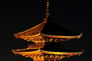 One of the landmarks of Kyoto, 'Yasaka Pagoda', looming in the dark in a golden hue