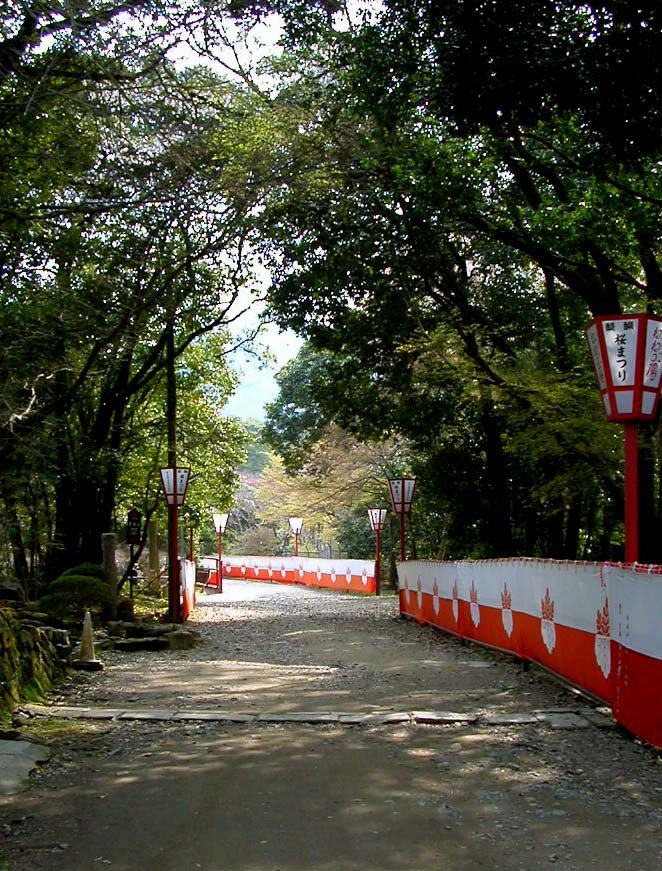 Red and white awnings (celebration colors in Japan) border some of the paths