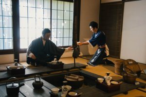 A scene of sake brewers tasting their sake