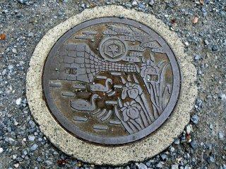 Menggambarkan parit-parit di Kastil Hikone