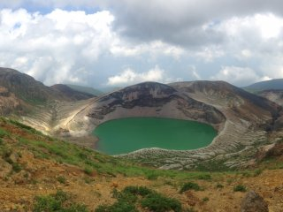 Okama, known as the Five-Colored Lake, because the color changes with the light and weather conditions