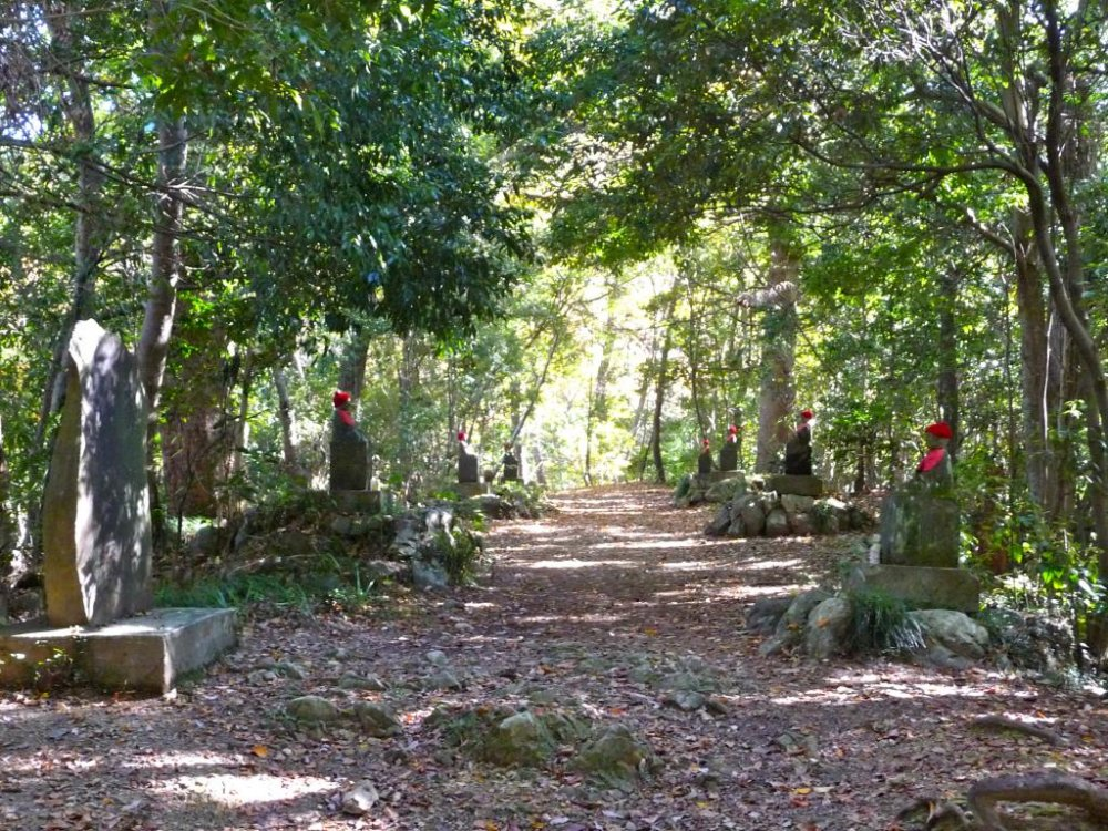 I loved walking through this path lined on both sides by trees and statues wearing red caps.  There is a very spiritual and peaceful feel to this place.