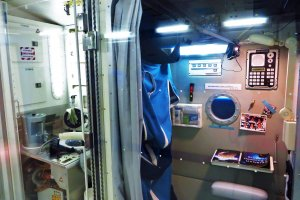 A reproduction of the inside of living quarters at the International Space Station