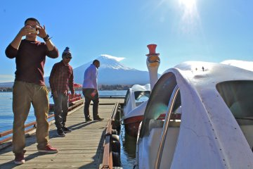 <p>My guests, Danny, John and Michael step onto the pier to pick up our swan boat rentals</p>
