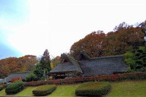 Old Japanese houses of Osagoe Folk Village Museum viewed from the street below