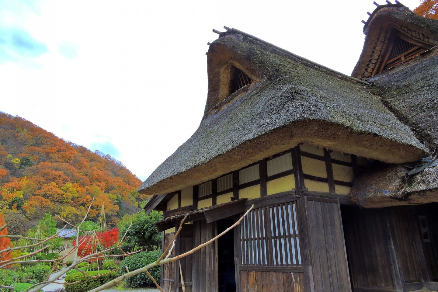 Old Japanese house with thatched roof at Osagoe Folk Village Museum in Fukui