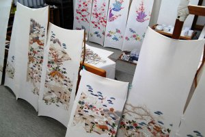 Painted silk panels in the yuzen workshop