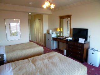 Ruangan-ruangan dengan dua tempat tidur, juga tersedia deluxe twin rooms, dan Junior Suites