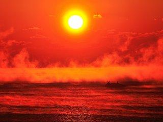The brilliant madder red sunrise burning in the sky left me speechless