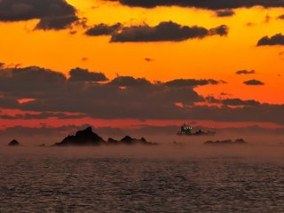 Just before sunrise, a mysterious ship materialized offshore. Is this a tanker?