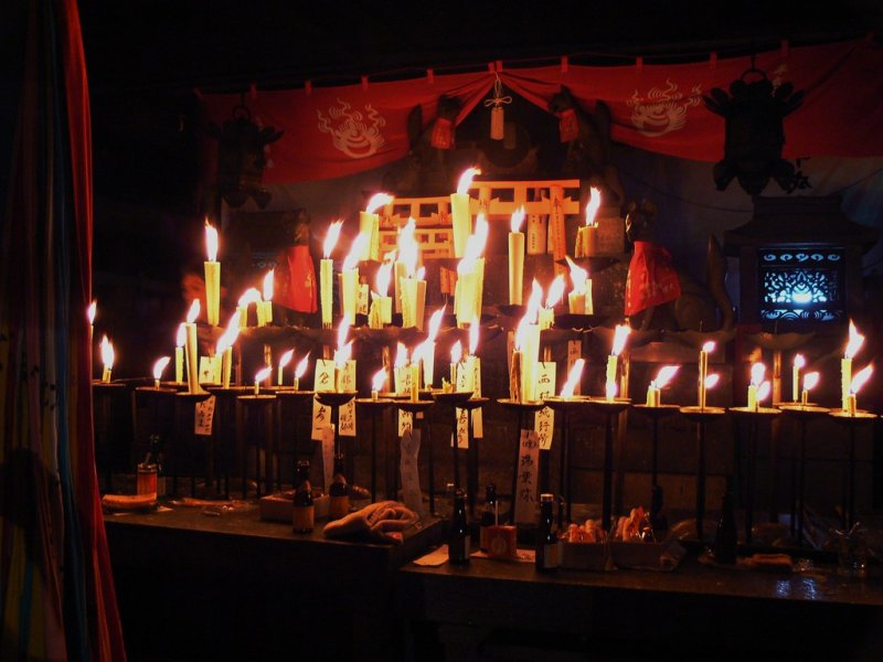 <p>Candles blazing on an altar</p>
