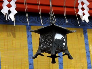 One of many beautiful metal lanterns hanging in the shrine buildings