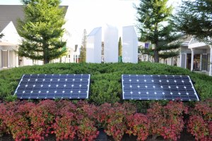 Solar panels power the Outlets' illuminations at night.
