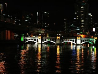 Beautiful Suisho (Crystal) Bridge over Dojima River with two types of arch creating an exquisite harmony. The lights reflected on the water surface are sparkling like crystal.