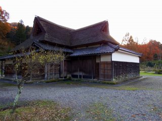 Traditional old Japanese house with thatched-roof in the park