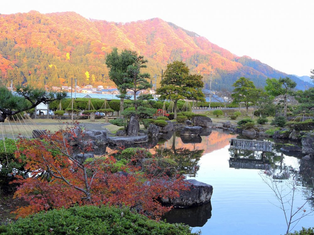 Japanese garden with colorful mountains in the background