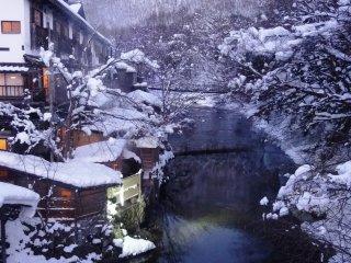 Riverside onsen, hidden behind bamboo screens