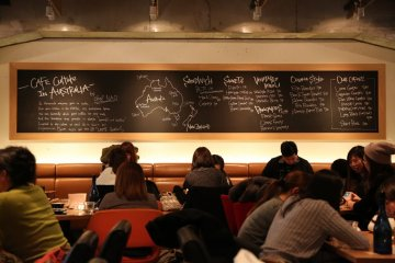 <p>Inside the cafe - a large chalk board with the message from the chef &amp; drawings of the Australian &amp; New Zealand maps</p>