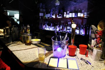<p>Bar is just behind the seating, serving both food and drinks</p>