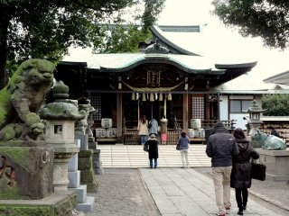 Visitors pray at the main shrine building