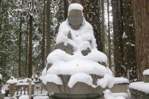 Buddha dressed in snow