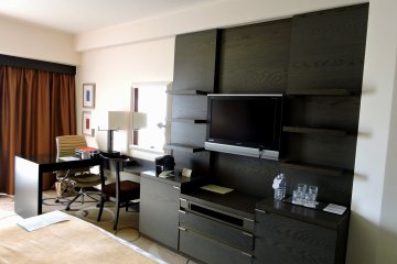 <p>Chic but warm interior of Deluxe Club Double Room. Two bottles of complimentary water are provided. Also, if you book a Club Room on 15th and 16th floor, you can use the Club Lounge which provides free snacks/drinks.</p>