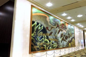 <p>A big painting on the wall of a corridor</p>
