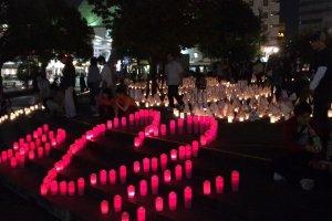 Near Karashima Park. Around the fountain, handmade paper lanterns illuminate the night