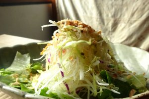 A shredded cabbage salad with a zesty dressing is the starter for all lunch sets