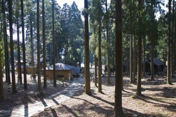 <p>View of the shrine, washrooms, and cabins from the tent area</p>