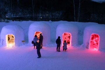 <p>People exploring the Yumoto Onsen Snow Festival</p>