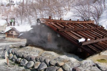 <p>Steam pouring out of the huts</p>