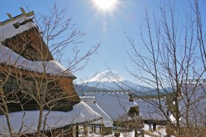 """Iyashino-Sato Nenba, also known as """"Healing Village,"""" is a magical getaway with incredible views of Mt. Fuji and thatched roof houses, especially in the wintertime."""
