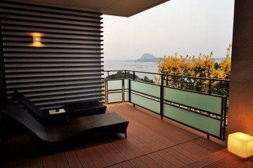 <p>Ocean view from the room&#39;s balcony. The private onsen bath is just out of view to the right.</p>