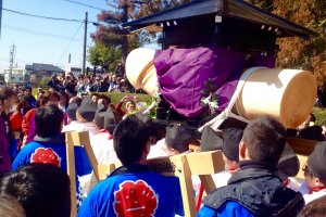 The mikoshi is hoisted up by a group of men all aged 42, and carried with much excitement to the main shrine.