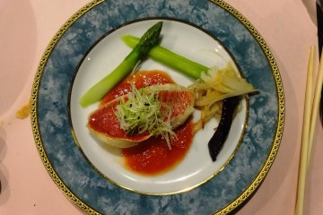 <p>A plate of fresh fish and vegetables was just one of the many dinner courses</p>