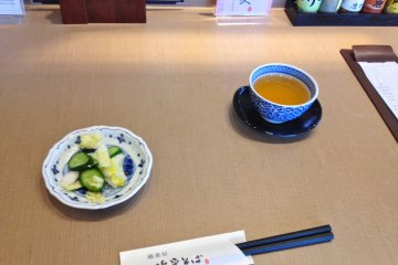 <p>Salt pickled cabbage and cucumber (tsukemono) and tea</p>