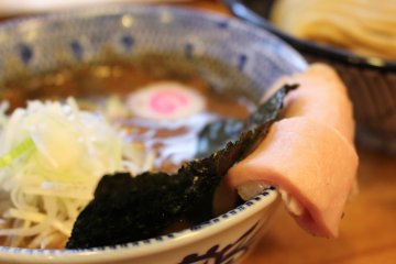 <p>Dipping broth with extra ingredients</p>