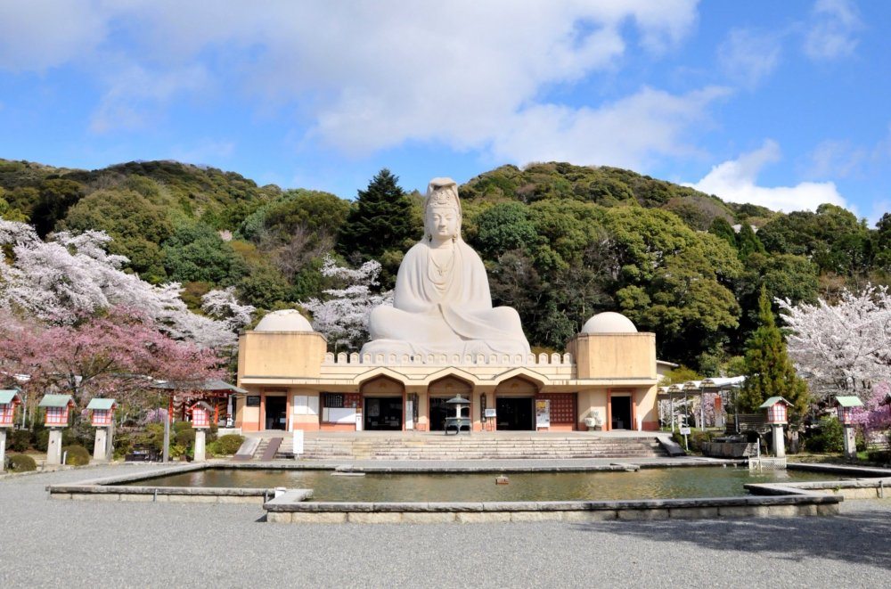 The 79 foot (23.7 meter) tall seated Kannon sits on top of the 'honden', or main hall.