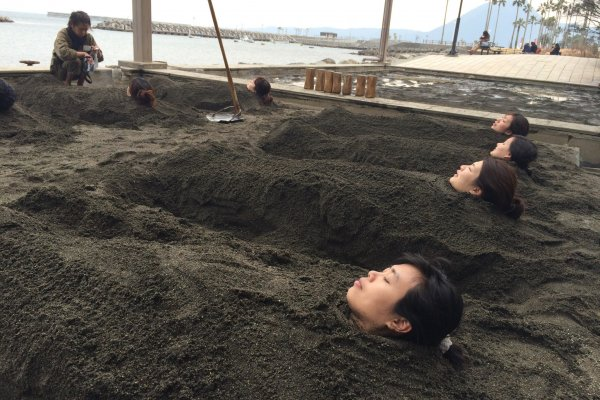 Buried under the warm sand by the beach