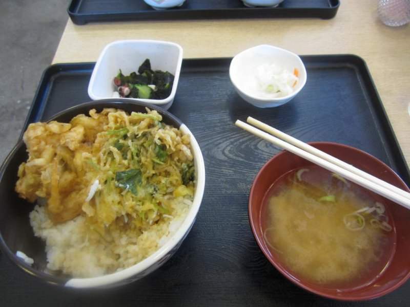 Deep-fried fish and onions on rice with miso soup and pickles