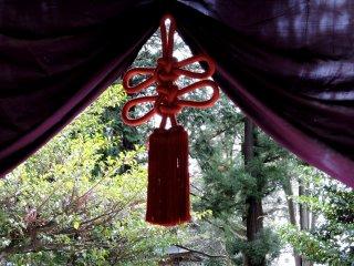 Ornate tassel on a purple curtain