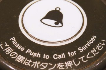 <p>Each table is given a &quot;call button&quot; which alerts a waitress when you are ready to order</p>