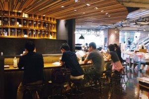 The bar seating at the Starbucks inside Tsutaya