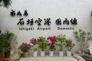 A sign welcomes visitors to PainushimaIshigaki Airport