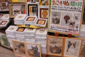 Different styles of cat art